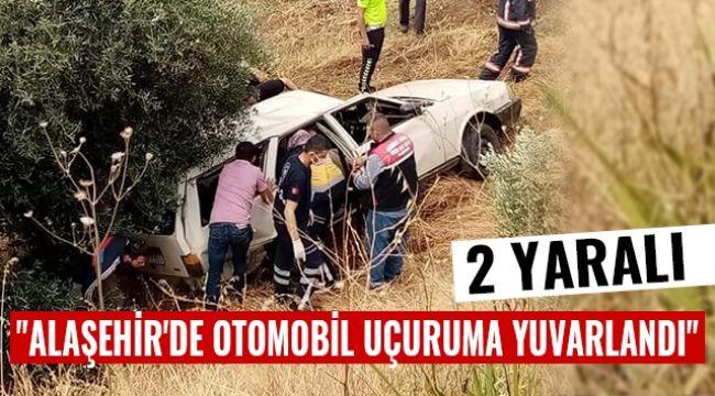 Alaşehir'de otomobil uçuruma yuvarlandı : 2 Yaralı